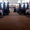 Officers stand to raise and arch of sabers as Tessa Thomas, center, and Naval Petty Officer 3rd class Colin Thomas, seated, prepare to leave the altar at the New Life Church on Friday, Oct. 20, 2017. Colin suffers from stage 4 pancreatic cancer which forced him from the Navy, and prompted a renewal of the couple's vows.<br /> <br /> <br /> (The Gazette, Nadav Soroker)
