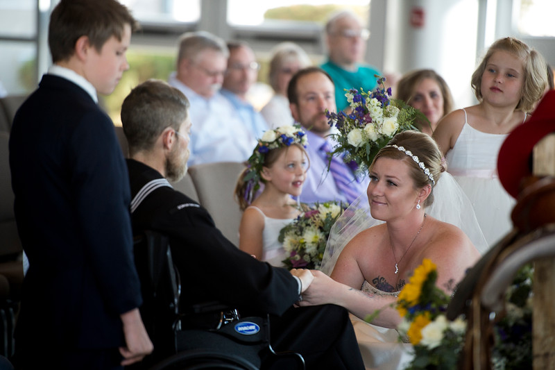 Tessa Thomas holds the hands of her husband, Naval Petty Officer 3rd class Colin Thomas, while renewing their wedding vows at the New Life Church on Friday, Oct. 20, 2017. Colin suffers from stage 4 pancreatic cancer which forced him from the Navy and prompted their renewal of vows.<br /> <br /> <br /> (The Gazette, Nadav Soroker)