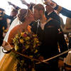 Tessa Thomas and Naval Petty Officer 3rd class Colin Thomas kiss before crossed sabres at the end of the ceremony where they renewed their wedding vows at the New Life Church on Friday, Oct. 20, 2017. Colin suffers from stage 4 pancreatic cancer which forced him from the Navy, and prompted the couple to renew their vows with more people in attendance.<br /> <br /> <br /> (The Gazette, Nadav Soroker)