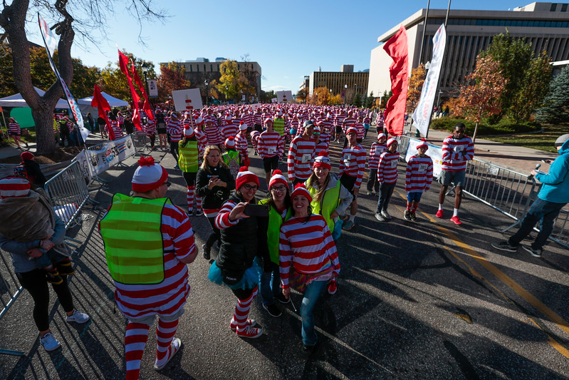 Volunteers and runners take a selfie at the head of a crowd of waldos before the Waldo Waldo 5k through downtown Colorado Springs on Saturday, Oct. 21, 2017.<br /> <br /> (The Gazette, Nadav Soroker)