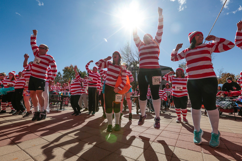 Runners and volunteers from the Waldo Waldo 5k dance in the beer garden set up for after the race on Saturday, Oct. 21, 2017.<br /> <br /> (The Gazette, Nadav Soroker)