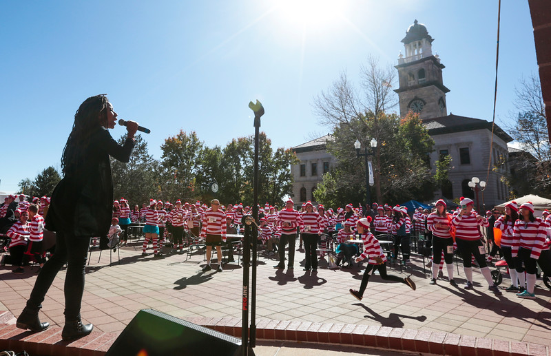 Aja Black of The Reminders sings in the post-race beer garden after the Waldo Waldo 5k on Saturday, Oct. 21, 2017.<br /> <br /> <br /> (The Gazette, Nadav Soroker)