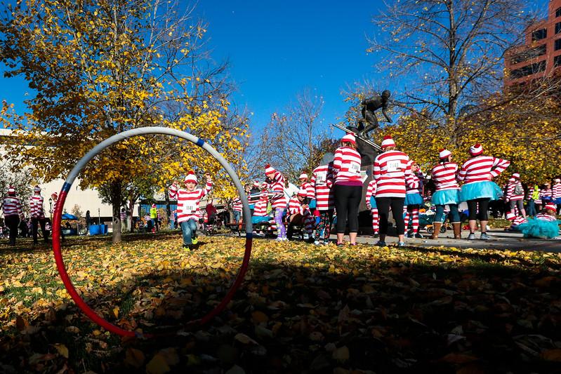 Kai Garrett, 5, chases a hula hoop rolled by his grandfather Robert Bogdanski at the celebrations before the Waldo Waldo 5k through downtown Colorado Springs on Saturday, Oct. 21, 2017.<br /> <br /> <br /> (The Gazette, Nadav Soroker)