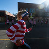 Collin Bruske races with the pace car at the lead of the Waldo Waldo 5k on Saturday, Oct. 21, 2017. Bruske flew home from Tabor College where he races cross-country to run with his family.<br /> <br /> (The Gazette, Nadav Soroker)