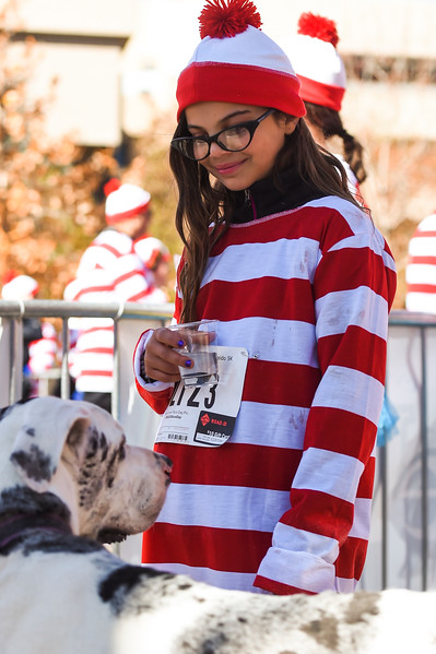 Rachel Khorashadi, 10, drinks water after finishing the Waldo Waldo 5k with her great dane Paddington on Saturday, Oct. 21, 2017.<br /> <br /> <br /> (The Gazette, Nadav Soroker)