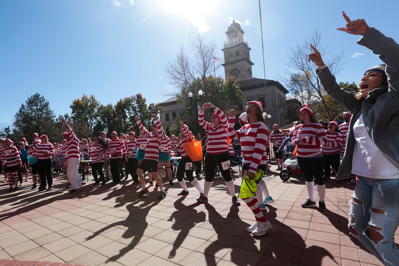 Runners and volunteers from the Waldo Waldo 5k dance in the beer garden set up for after the race on Saturday, Oct. 21, 2017.<br /> <br /> <br /> (The Gazette, Nadav Soroker)