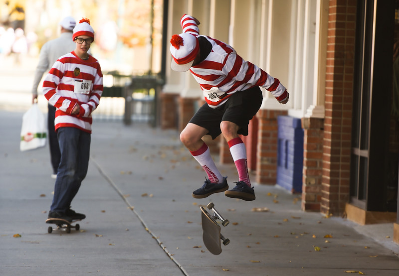 Mike Ambrose does a kick flip during the Waldo Waldo 5k on Saturday, Oct. 21, 2017. Ambrose appreciated that no one officiating the fundraising fun-run had any problems with him skateboarding instead of running.<br /> <br /> (The Gazette, Nadav Soroker)