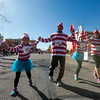 Mina Rodriguez-Sanchez, left, high fives a race volunteer while crossing the finish line of the Waldo Waldo 5k with her family, Cristobal, Maya and Andrea Rodriguez-Sanchez, on Saturday, Oct. 21, 2017.<br /> <br /> (The Gazette, Nadav Soroker)
