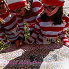 Sandy McCarthy, Denise Polenske and Heather Thomas search for Waldo while dressed in Waldo costumes at the Waldo Waldo 5k through downtown Colorado Springs on Saturday, Oct. 21, 2017. <br /> <br /> (The Gazette, Nadav Soroker)