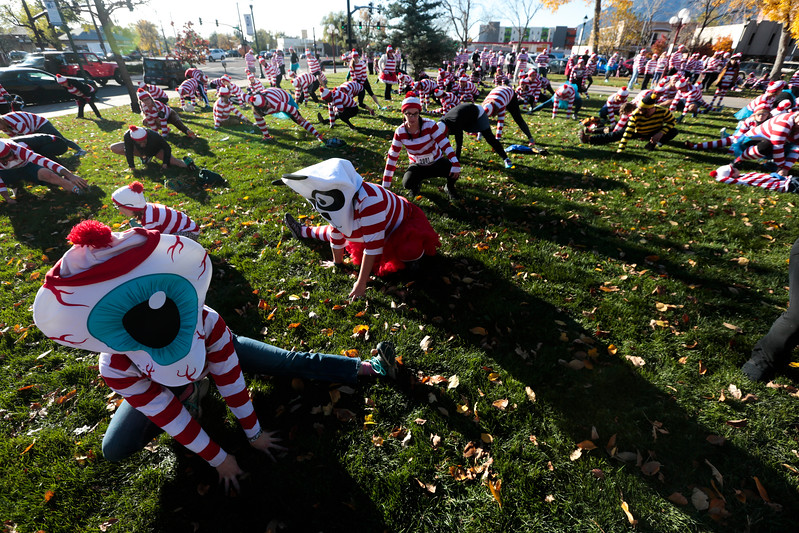 Becca Sickbert, eyeball, stretches on the lawn of the Pioneer Museum before the Waldo Waldo 5k through downtown Colorado Springs to raise money for the Waldo Canyon Fire on Saturday, Oct. 21, 2017. Sickbert works for Elope, the presenting sponsor of the race.<br /> <br /> <br /> (The Gazette, Nadav Soroker)
