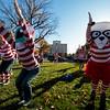 Becca Sickbert, eyeball, and Holly Dempsey, panda, raise their arms during yoga before the Waldo Waldo 5k through downtown Colorado Springs to raise money for the Waldo Canyon restoration on Saturday, Oct. 21, 2017. Sickbert and Dempsey work for Elope, the presenting sponsor of the race.<br /> <br /> <br /> (The Gazette, Nadav Soroker)