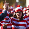 A woman high fives a race volunteer as she sets out for the Waldo Waldo 5k on Saturday, Oct. 21, 2017.<br /> <br /> <br /> (The Gazette, Nadav Soroker)