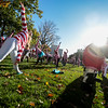 A field of waldos and a cow from Chik-fil-a stretch out with yoga before the Waldo Waldo 5k through downtown Colorado Springs to raise money for the Waldo Canyon Fire on Saturday, Oct. 21, 2017.<br /> <br /> <br /> (The Gazette, Nadav Soroker)