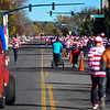 Collin Bruske, left, chases the pace car at the lead of the Waldo Waldo 5k on Saturday, Oct. 21, 2017. Bruske flew home from Tabor College where he races cross-country to run with his family.<br /> <br /> (The Gazette, Nadav Soroker)