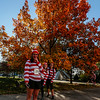 Leah Young laughs after a selfie while her friends Katie Corcoran and Ketanny Alves pose behind her before the Waldo Waldo 5k through downtown Colorado Springs to raise money for the Waldo Canyon Fire on Saturday, Oct. 21, 2017.<br /> <br /> <br /> (The Gazette, Nadav Soroker)