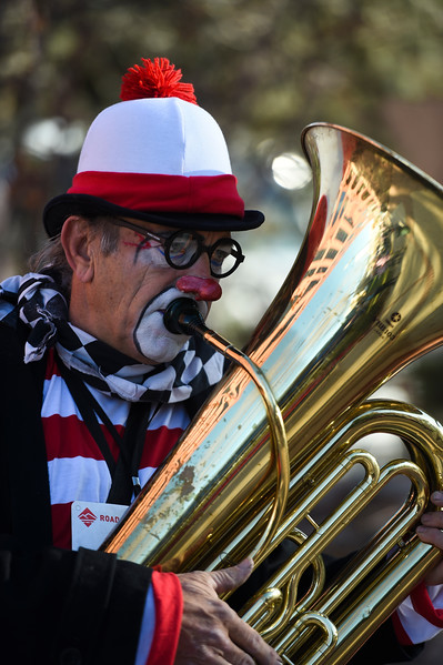 Jeff Stone as Joey the Clown plays his tuba while waiting for the Waldo Waldo 5k to start on Saturday, Oct. 21, 2017. Stone was directing everyone who wanted to tip him to donate to the event instead.<br /> <br /> <br /> (The Gazette, Nadav Soroker)