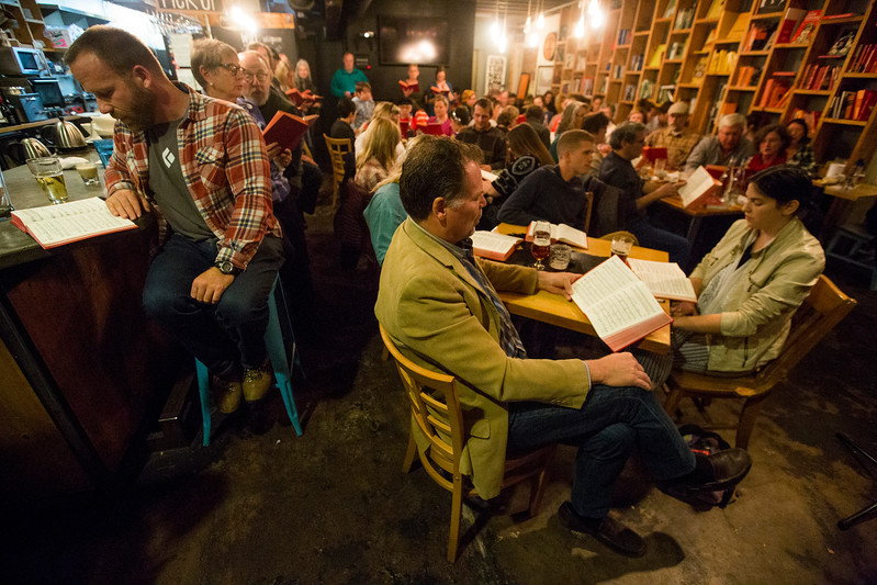 Robert Seel, left sings from the hymnal as Peter Tuff, center, sings along<br /> <br /> Worshippers gathered to drink beer and sing hymns in the Wild Goose Meeting House in Colorado Springs, Colo. on Sunday, Oct. 22, 2017.<br /> <br /> <br /> (The Gazette, Nadav Soroker)