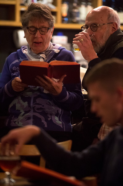 Cathy White sings from the hymnal while her husband Jerry White drinks<br /> <br /> Worshippers gathered to drink beer and sing hymns in the Wild Goose Meeting House in Colorado Springs, Colo. on Sunday, Oct. 22, 2017.<br /> <br /> <br /> (The Gazette, Nadav Soroker)