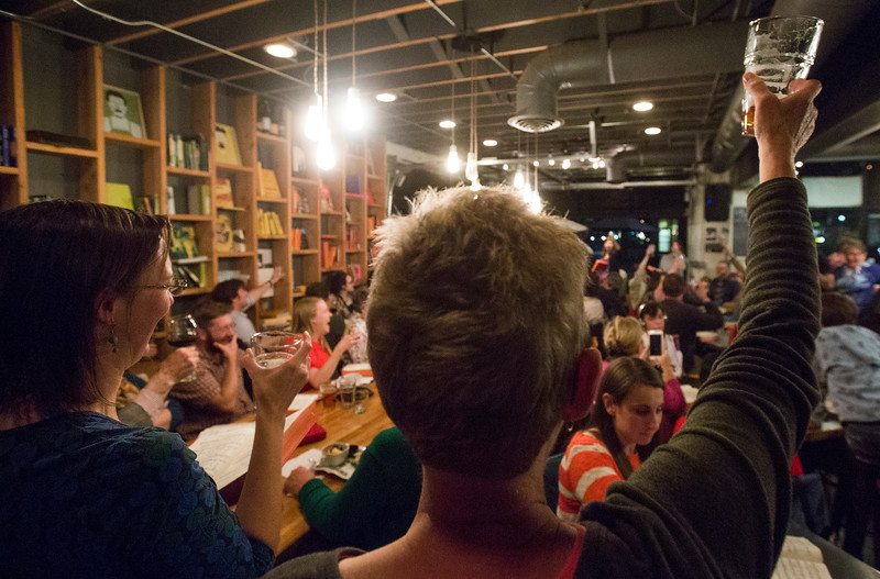 Jessica Gemm, left, Debra Buenting, glass up<br /> <br /> Worshippers gathered to drink beer and sing hymns in the Wild Goose Meeting House in Colorado Springs, Colo. on Sunday, Oct. 22, 2017.<br /> <br /> <br /> (The Gazette, Nadav Soroker)