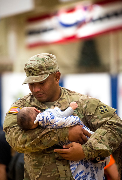 "Sergeant Anthony Noda holds his son Amell, 3 months, at the homecoming for the 3rd Armored Brigade in the William ""Bill"" Reed Special Events Center in Fort Carson, Colo. on Sunday, Oct. 22, 2017. Noda was able to return from his deployment to see his son born, but only had a week with him before returning to Europe.<br /> <br /> <br /> (The Gazette, Nadav Soroker)"