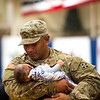 """Sergeant Anthony Noda holds his son Amell, 3 months, at the homecoming for the 3rd Armored Brigade in the William """"Bill"""" Reed Special Events Center in Fort Carson, Colo. on Sunday, Oct. 22, 2017. Noda was able to return from his deployment to see his son born, but only had a week with him before returning to Europe.<br /> <br /> <br /> (The Gazette, Nadav Soroker)"""