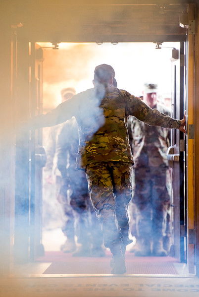 "A soldier opens the doors to the William ""Bill"" Reed Special Events Center to admit members of the 3rd Armored Brigade for their homecoming in Fort Carson, Colo. on Sunday, Oct. 22, 2017.<br /> <br /> <br /> (The Gazette, Nadav Soroker)"