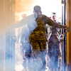 """A soldier opens the doors to the William """"Bill"""" Reed Special Events Center to admit members of the 3rd Armored Brigade for their homecoming in Fort Carson, Colo. on Sunday, Oct. 22, 2017.<br /> <br /> <br /> (The Gazette, Nadav Soroker)"""