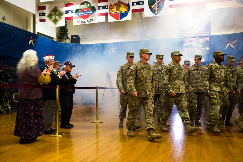 "Members of the 3rd Armored Brigade walk into the gymnasium for their homecoming while attendees clap in the William ""Bill"" Reed Special Events Center in Fort Carson, Colo. on Sunday, Oct. 22, 2017.<br /> <br /> <br /> (The Gazette, Nadav Soroker)"