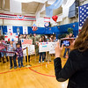 """A woman takes a photograph of kids holding welcome back signs at the William """"Bill"""" Reed Special Events Center in Fort Carson, Colo. on Sunday, Oct. 22, 2017. The final members of the 3rd Armored Brigade returned from a training deployment in Eastern Europe.<br /> <br /> <br /> (The Gazette, Nadav Soroker)"""