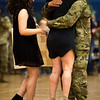 """Staff Sergeant Edgardo Rodriguez hugs his wife Vicky Rodriguez as their daughter Daniela Rodriguez runs up to them at the homecoming for the 3rd Armored Brigade in the William """"Bill"""" Reed Special Events Center in Fort Carson, Colo. on Sunday, Oct. 22, 2017.<br /> <br /> <br /> (The Gazette, Nadav Soroker)"""