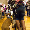 """Staff Sergeant Joshua Reed hugs his wife Monique Reed into the air while their boxer, Sasha, watches in the William """"Bill"""" Reed Special Events Center in Fort Carson, Colo. on Saturday, Oct. 21, 2017.<br /> <br /> <br /> (The Gazette, Nadav Soroker)"""