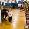 """Specialist Tyler O'Neel talks with his son Trace, 1, while his wife Hayley O'Neel takes their photo after the 3rd Armored Brigade homecoming in the William """"Bill"""" Reed Special Events Center in Fort Carson, Colo. on Sunday, Oct. 22, 2017. O'Neel's family wasn't sure if Tyler would remember him, but the two easily reconnected.<br /> <br /> <br /> (The Gazette, Nadav Soroker)"""