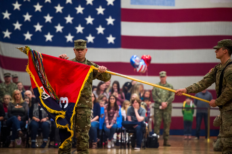 "Colonel Michael Simmering unveils the flag of the 3rd Armored Brigade at the homecoming for the brigade's final members in the William ""Bill"" Reed Special Events Center in Fort Carson, Colo. on Sunday, Oct. 22, 2017. The uncasing of the colors signified the successful completion of the brigade's training mission to eastern Europe.<br /> <br /> <br /> (The Gazette, Nadav Soroker)"
