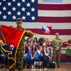 """Colonel Michael Simmering unveils the flag of the 3rd Armored Brigade at the homecoming for the brigade's final members in the William """"Bill"""" Reed Special Events Center in Fort Carson, Colo. on Sunday, Oct. 22, 2017. The uncasing of the colors signified the successful completion of the brigade's training mission to eastern Europe.<br /> <br /> <br /> (The Gazette, Nadav Soroker)"""