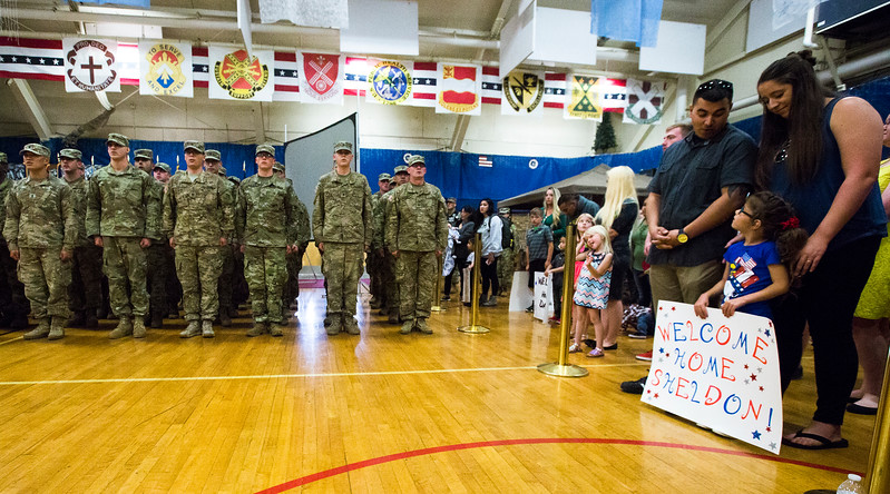 """A family waits for the final word, """"Dismissed!"""" so that they can run out to welcome home their member of the 3rd Armored Brigade in the William """"Bill"""" Reed Special Events Center in Fort Carson, Colo. on Sunday, Oct. 22, 2017.<br /> <br /> <br /> (The Gazette, Nadav Soroker)"""