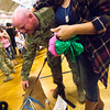 """Staff Sergeant Joshua Reed pets Sasha while his wife, Monique Reed, watches at the homecoming for the 3rd Armored Brigade in the William """"Bill"""" Reed Special Events Center in Fort Carson, Colo. on Sunday, Oct. 22, 2017.<br /> <br /> <br /> (The Gazette, Nadav Soroker)"""