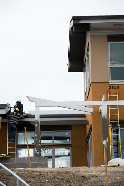 Workers put the finishing touches on the entryway to the Retreat at Sunny Vista building on Monday, Oct. 23, 2017. The new building, part of the Sunny Vista Living Center, will be dedicated for memory care and more assisted living space.<br /> <br /> <br /> (The Gazette, Nadav Soroker)