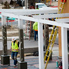 A worker passes by the columns outside the under-construction Retreat at Sunny Vista on Monday, Oct. 23, 2017. The new building, part of the Sunny Vista Living Center, will be dedicated for memory care and more assisted living space.<br /> <br /> <br /> (The Gazette, Nadav Soroker)