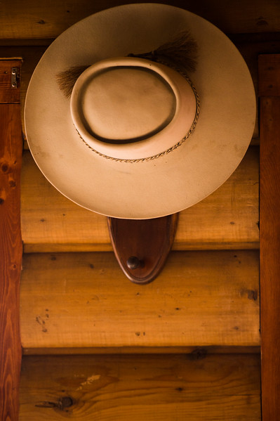 A hat rests near the door of the lodge Glenn Ryan lives in at AG Ranch in Bailey, Colo. on Tuesday, Oct. 24, 2017.<br /> <br /> <br /> (The Gazette, Nadav Soroker)
