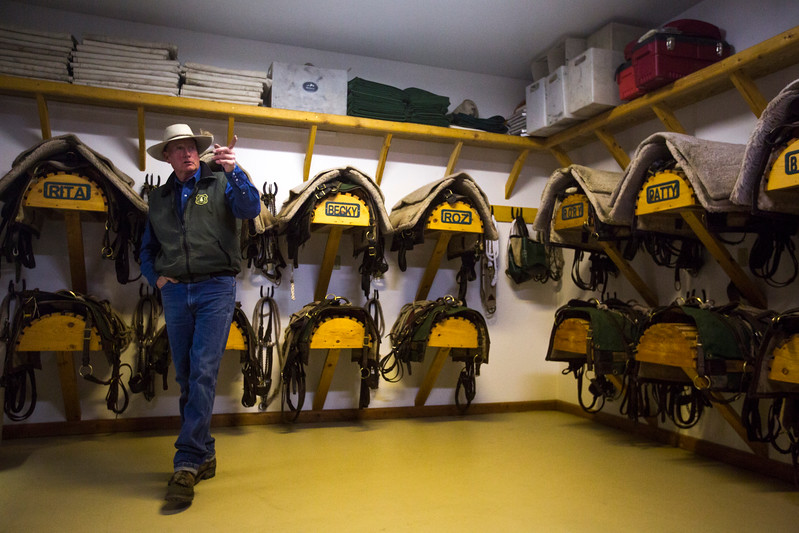 Glenn Ryan explains all the names for his mules in their tack room at AG Ranch in Bailey, Colo. on Tuesday, Oct. 24, 2017. Ryan named all the mules that he manages for the Forest Service and has had them all since he moved to the ranch in 2004.<br /> <br /> <br /> (The Gazette, Nadav Soroker)