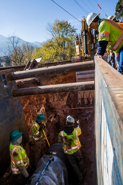 Members of Wildcat Construction and Colorado Springs Utilities work to lay 7,500 ft. of new 30-inch pipe to replace 83-year-old mains leading from reservoirs on Pikes Peak to the Mesa Hydro plant, on Friday, Nov. 3, 2017.