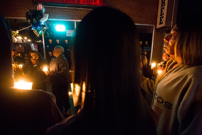 Charmaine Jones, left, wipes away her tears surrounded by her family members and friends of her brother Conte Smith-El at his vigil on Friday, Nov. 3, 2017. Smith-El was killed at a business on East Platte avenue on Monday night, Oct. 30.