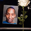 A photo of Conte Smith-El hangs on the door of the shop where he was killed after it was decorated for a candlelight vigil on Friday, Nov. 3, 2017. Smith-El was killed at a business on East Platte avenue on Monday night, Oct. 30.