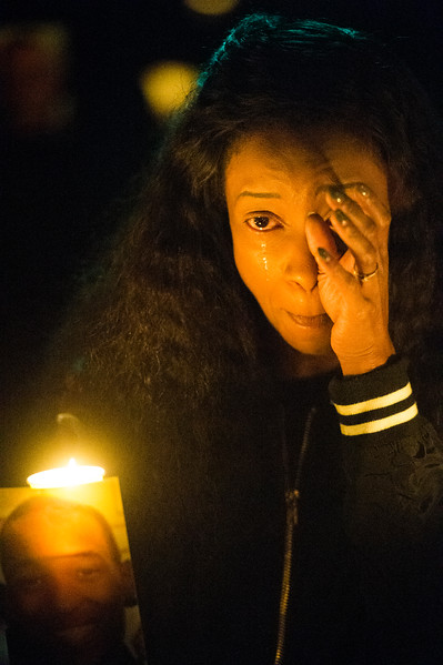 Charmaine Jones wipes away tears while leading a vigil for her brother Conte Smith-El on Friday, Nov. 3, 2017. Smith-El was killed at a business on East Platte avenue on Monday night, Oct. 30.
