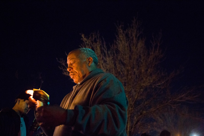 Conte Smith-El lights a candle for his son, also Conte Smith-El, on Friday, Nov. 3, 2017. The younger Smith-El was killed at a business on East Platte avenue on Monday night, Oct. 30.