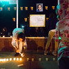 Shatima Walker lights candles at a vigil for Conte Smith-El, outside of the storefront where he was killed, on Friday, Nov. 3, 2017. Smith-El was killed at a business on East Platte avenue on Monday night, Oct. 30.