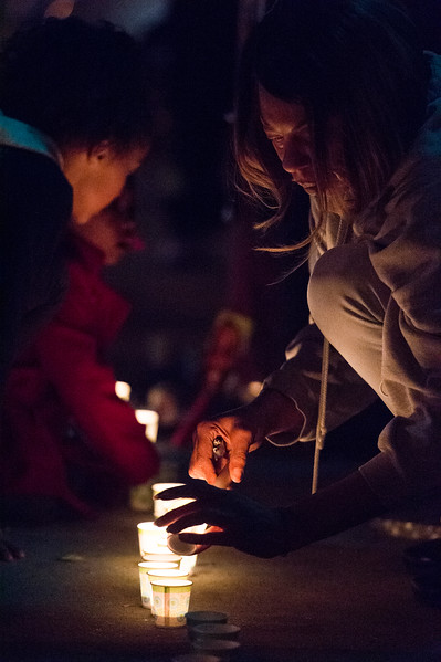 Shatima Walker lights candles at a vigil for Conte Smith-El on Friday, Nov. 3, 2017. Smith-El was killed at a business on East Platte avenue on Monday night, Oct. 30.