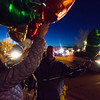 Conte Smith-El, center, and Lisa Smith arrange balloons for the vigil of Smith-El's son, also Conte Smith-El, on Friday, Nov. 3, 2017. Smith-El was killed at a business on East Platte avenue on Monday night, Oct. 30.