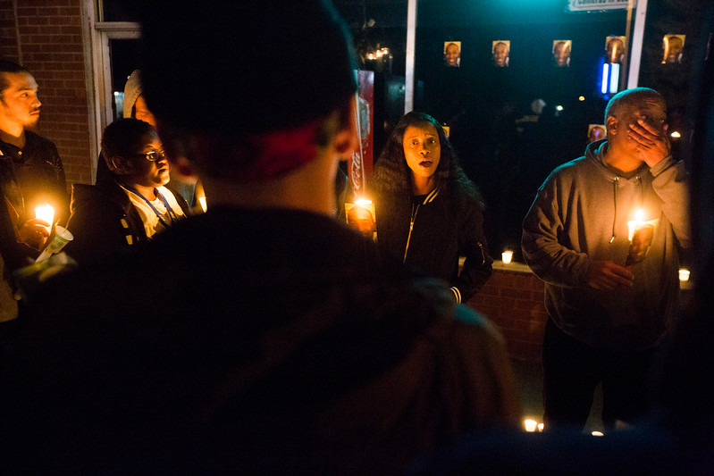Charmaine Jones, center, speaks at the vigil for her brother Conte Smith-El, while her father, right, also Conte Smith-El, struggles to maintain his composure on Friday, Nov. 3, 2017. The younger Smith-El was killed at a business on East Platte avenue on Monday night, Oct. 30.