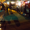 Family and friends of Conte Smith-El gather outside the storefront where he was killed for a candlelight vigil on Friday, Nov. 3, 2017. Smith-El was killed at a business on East Platte avenue on Monday night, Oct. 30.